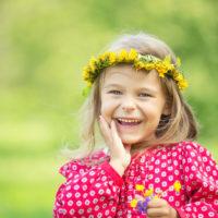 Portrait of happy little girl in spring park