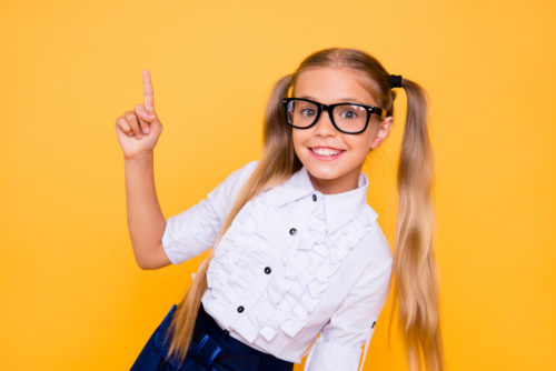Back to school! First grade junior lifestyle teen concept. Close up studio photo portrait of cute girl gesturing up wearing trendy blouse white outfit isolated bright shine background